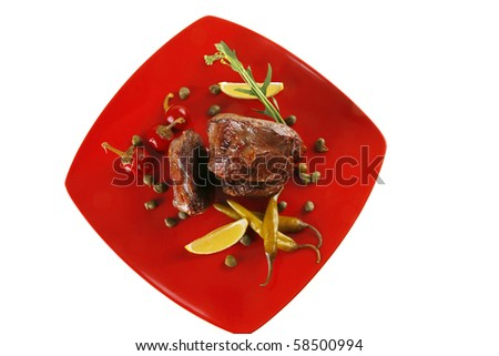 grilled meat medallion served with tomatoes on red