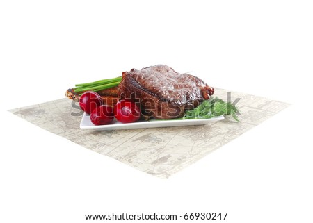 grilled meat on dish with bread and vegetables - stock photo