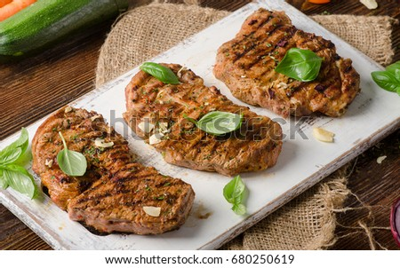 Grilled meat  on rustic wooden table.