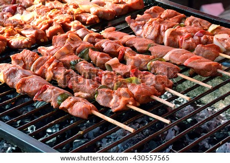 grilled meat on the barbecue in the garden - stock photo
