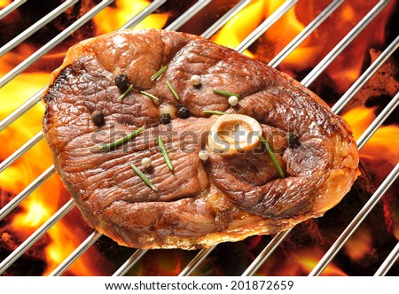 Grilled meat on the flaming grill ( lamb leg ) - stock photo