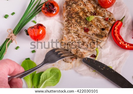 Grilled Meat. Perfect Grilled Steak with Herb Butter features a homemade dry rub. Roasted Pork with vegetables.  - stock photo