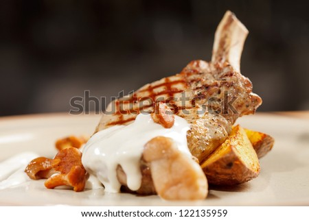 Grilled meat ribs with potatoes - stock photo