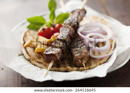 grilled meat skewer on pita bread - stock photo