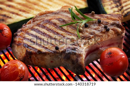 Grilled meat steak and vegetables on grill - stock photo