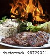 Grilled meat with accompaniments - stock photo