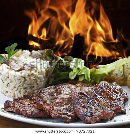 Grilled meat with accompaniments