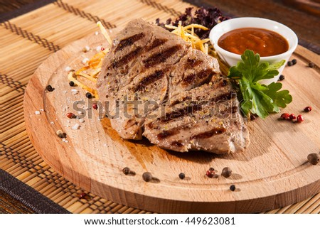 grilled meat with barbecue sauce on wooden background