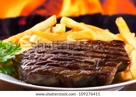 grilled meat with french fries - stock photo