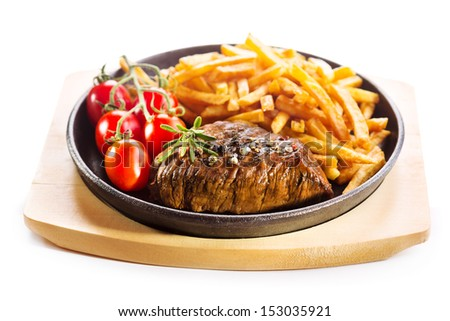grilled meat with french fries in a pan on white background
