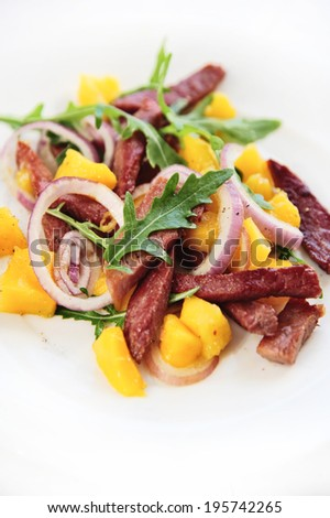 Grilled meat with fresh mango salad
