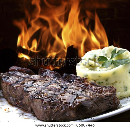 Grilled meat with mashed potatoes - stock photo