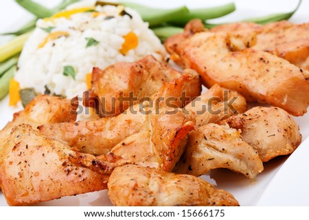 Grilled meat with rice and vegetables - stock photo