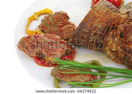 grilled meat with slices served on plate