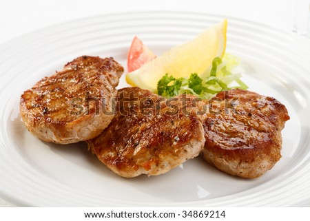 Grilled meat with vegetable salad