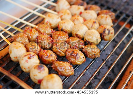 grilled meatballs, asian street food - stock photo