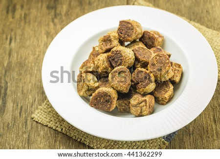 grilled meatballs black chicken for health on wooden background  - stock photo