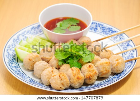 Grilled meatballs stick  on plate with sauce - stock photo