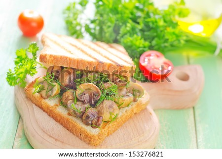 Grilled mushrooms on bread - stock photo