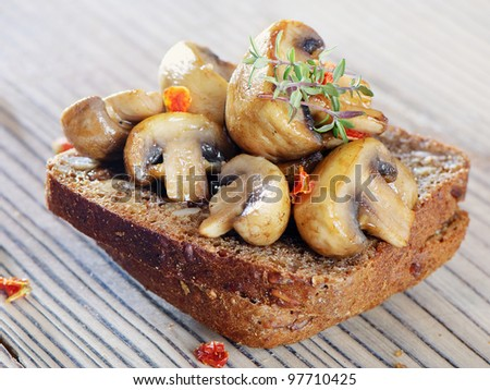 Grilled mushrooms on healthy bread - stock photo