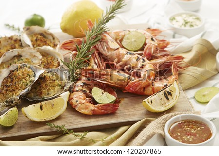 Grilled mussels and grilled shrimps with lemon ,fresh from kitchen. - stock photo