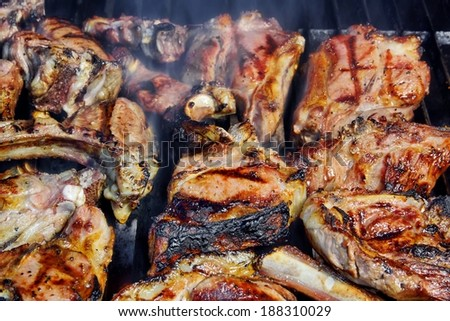 Grilled Mutton Ribs on BBQ Grate. You can see more BBQ, Grilled food, flames and fire on my page. - stock photo