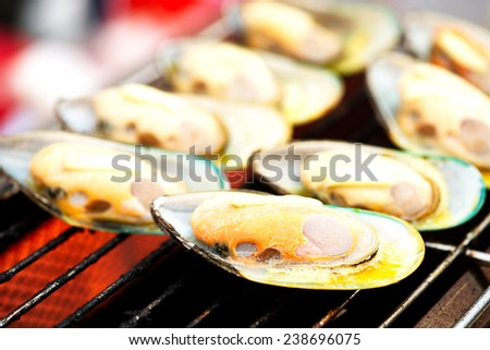 Grilled New Zealand mussels. - stock photo