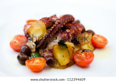 Grilled octopus with cherry tomatoes - stock photo