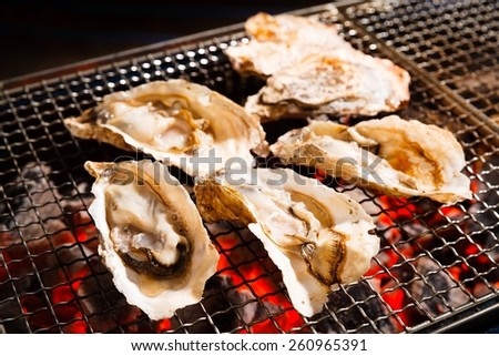 Grilled oysters - stock photo