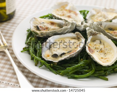 Grilled Oysters with Mornay Sauce on Samphire - stock photo