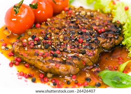 grilled pepper-steak with tomato,lettuce - stock photo