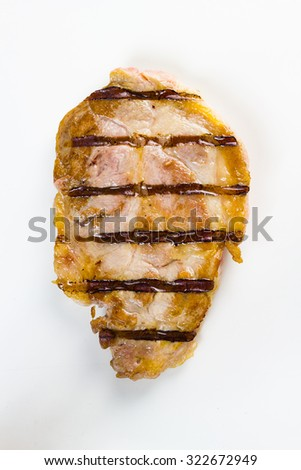 Grilled piece of pork, isolated on white. - stock photo