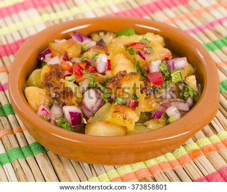 Grilled Pineapple Salsa - Mexican style salad with grilled pineapple, tomatoes, onions, peppers, coriander and chillies. - stock photo