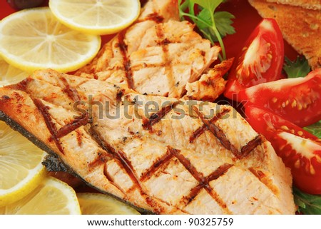 grilled pink salmon with lemon and toasts