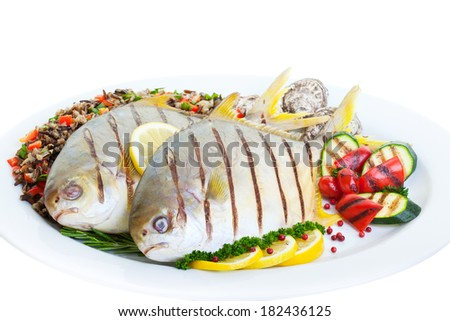 Grilled Pompano fish with wild rice ,vegetables and oysters on a white background. - stock photo