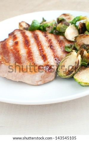 Grilled pork and cut brussels sprouts