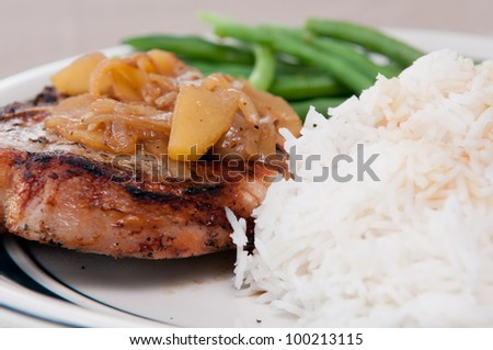 grilled pork chop with apple sauce, fresh white rice and green beans