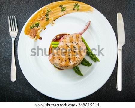 Grilled Pork chop with asparagus  - stock photo