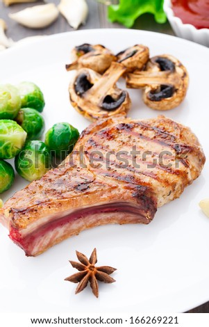 Grilled pork chop with brussels sprouts - stock photo