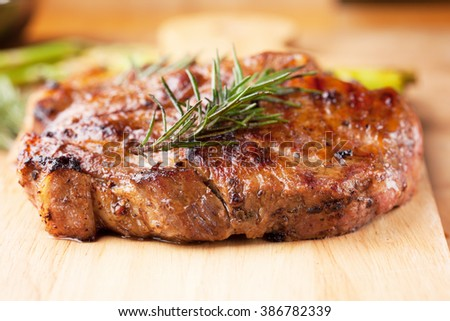 grilled pork chop with rosemary  - stock photo