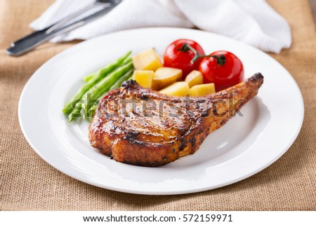 grilled pork chop with vegetable for meal