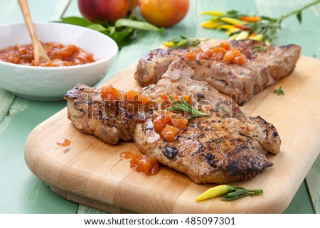 Grilled pork chops with nectarine - pepper chutney. Fresh nectarines and hot pepper.