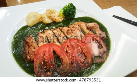 Grilled pork in basil sauce. Japanese cuisine.