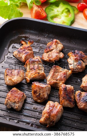 grilled pork in pan and vegetable - stock photo