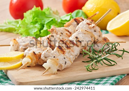 Grilled pork kebab with onions - stock photo