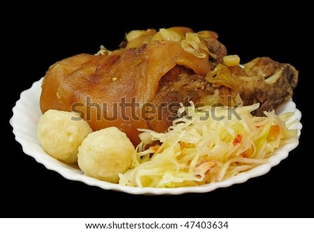 Grilled pork knee with cabbage and pastry - stock photo