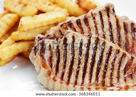 Grilled pork meat  with fried potatoes
