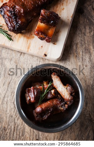 grilled pork rib in stainless steel bowl - stock photo
