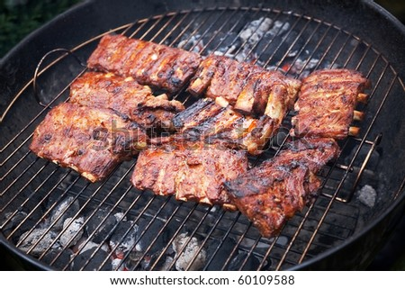 grilled pork ribs on bbq grill with a shallow DOF - stock photo