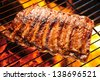 Grilled pork ribs on the grill. - stock